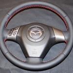 перетяжка салона Mazda 3