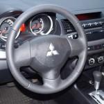 Mitsubishi Lancer Х руль перфорированной кожей